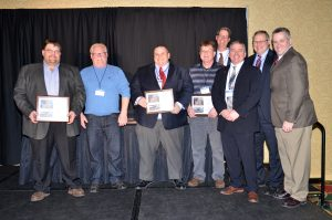 Recipients of the Outstanding Highway Construction Project Award for Excellence in Grading at the 2017 WTBA Contractor/Engineer Conference Awards Ceremony. L-R: Rep from James Peterson Sons, Inc., Tim Peterson, Project Leader Adam Ericksen, Project Manager Ross Johnson, unknown, WisDOT Division of Transportation System Development administrator Joe Olson, WisDOT Division of Transportation System Development deputy administrator Dewayne Johnson, and WTBA Executive Director Pat Goss.